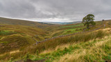 Grey clouds over the North Pennines landscape near Allenheads in Northumberland, England, UK - 242510801