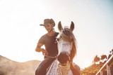 Cowboy riding horse inside finca's corral - 242512238