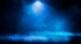 Blue misty dark background. Dark street with smoke, fog, blue spotlights, neon. Dark abstract empty background.