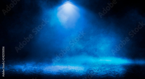 Foto Murales Blue misty dark background. Dark street with smoke, fog, blue spotlights, neon. Dark abstract empty background.