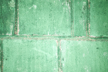 Putty green concrete block wall. background
