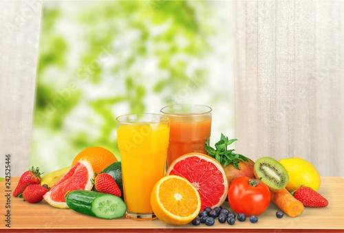 Orange juice and slices of orange on background