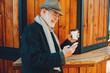 Leinwanddruck Bild - Elegant old man in a sunny autumn park