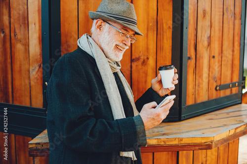 Leinwanddruck Bild Elegant old man in a sunny autumn park