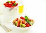 Summer salad with strawberries, kiwi and banana.