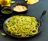 Spaghetti with pesto of arugula with pine nuts