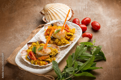 saffron couscous with scallop eggplant and tomatoes