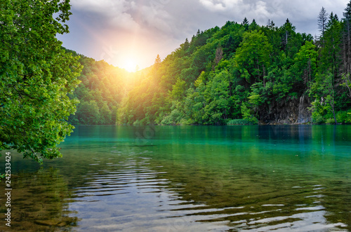 Lakes and waterfalls among the dense forest. - 242533424