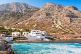 Coast of Sifnos island. The Kamares village surrounded by beautiful mountains. Greece - 242534663