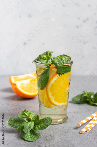 Glass with homemade orange lemonade with mint. Copy space for text.