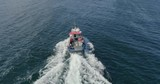 Aerial footage of a small fishing boat crossing the sea near Fraserburgh harbour in Aberdeenshire - 242546050