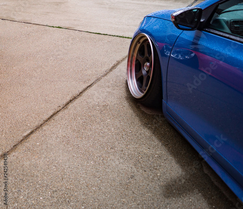 tuning, bright sports car standing on concrete - 242549438