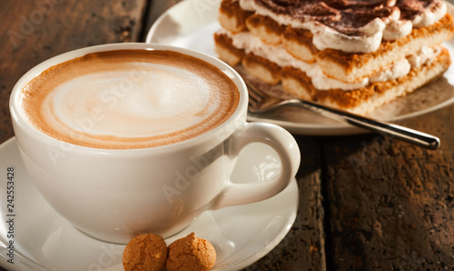 White ceramic cup of coffee with dessert - 242553428
