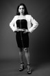 Full length portrait of transgender businesswoman in black and white
