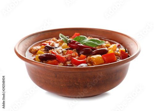 Bowl with tasty chili con carne on white background - 242568434