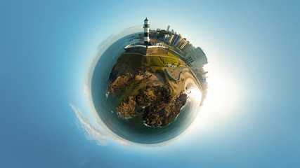 Little Planet of Barra Lighthouse (Farol da Barra) in Salvador, Brazil. It was built in 1698, first lighthouse in the Americas