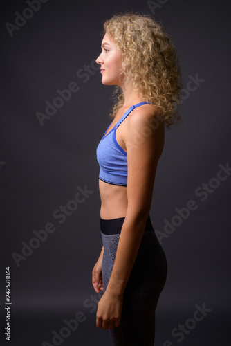 Profile view of young beautiful sport woman ready for gym