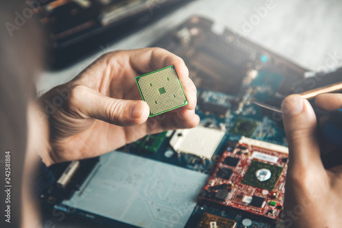 Foto Murales man hand microchip