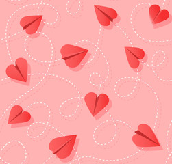 Seamless Valentines Day pattern of heart shaped paper airplanes. Flying red hearts on pink background.  Vector Illustration