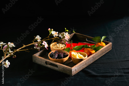 Group of colorful Vietnamese jam for Vietnam Tet holiday, also lunar new year of Asia, traditional preserved fruit from jujube, ginger jam and pumpkin seeds, tangerine