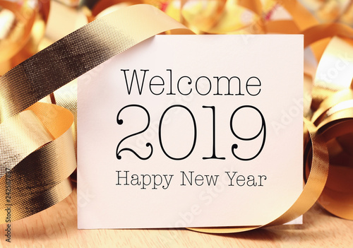 Welcome 2019 with decoration and the ribbon.