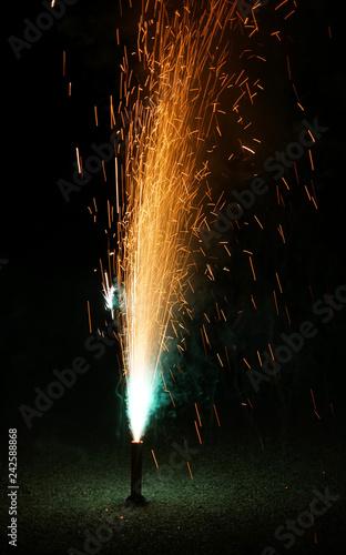colorful fountain fireworks stream into dark night