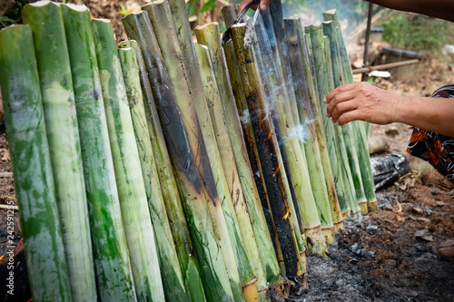 make glutinous rice with coconut milk roasted in a length bamboo joints cylinder, Khao Lam is Traditional Thai sweet dessert