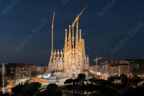 Night view of the Sagrada Familia, a large Roman Catholic church in Barcelona, Spain, designed by Catalan architect Antoni Gaudi.
