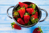 Strawberries on wooden table - 242600812