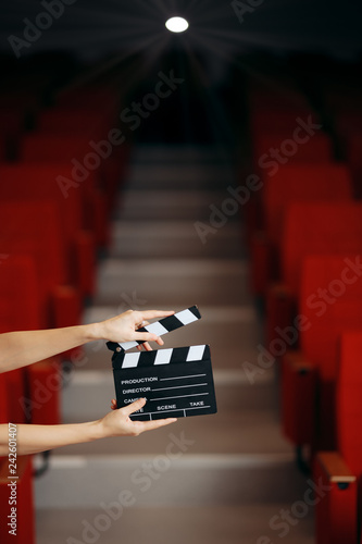 Leinwandbild Motiv Hands Holding Director Movie Clapper in Cinema Theatre