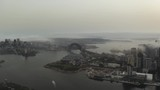 Sydney Harbour Bridge from a distance on a foggy morning - 242611853