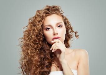 Beautiful blonde woman with long healthy curly hair © artmim