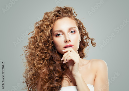 Beautiful blonde woman with long healthy curly hair