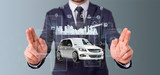 Fototapeta Miasto - Businessman holding Dashboard smartcar interface with multimedia icon and city map on a background 3d rendering © Production Perig