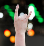 Two fingers on the hand at the concert - 242623058