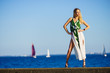 Fashion woman against yachts on sea