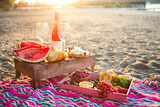 Picnic with rose wine, fruits, nuts meat and cheese