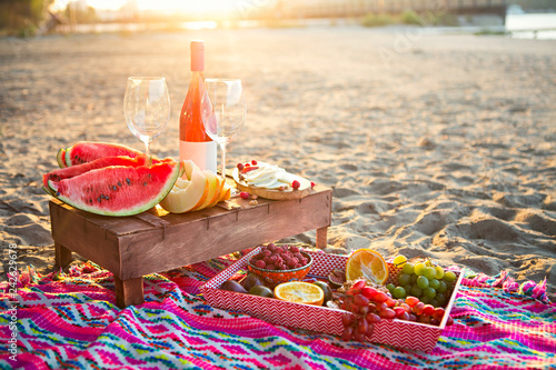 Leinwanddruck Bild Picnic with rose wine, fruits, nuts meat and cheese
