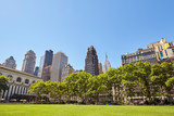 New York City skyline on a sunny summer day seen from the Bryant Park, USA.