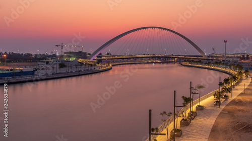 obraz lub plakat View of the Tolerance Bridge and the Dubai Water Canal during Sunset.