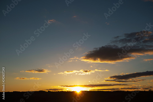 Foto Murales Sunset sky background. Landscape and dramatic sunset or sunrise sky in summer.