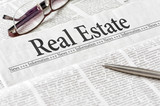A newspaper with the headline Real Estate - 242638429