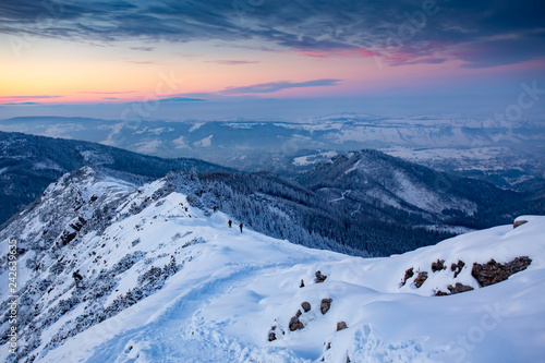 Hiking people in the mountains snow winter in Europe.  Kasprowy wierch, Tatra mountian, Poland