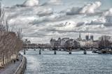 Pont des Arts and Ile de la Cite in winter under a heavy sky - Paris, France