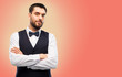 people concept - man in party clothes and bowtie over living coral background