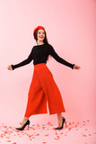 Full length portrait of a beautiful young woman - 242646413
