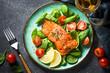 Leinwanddruck Bild - Baked salmon fish fillet with fresh salad top view.