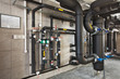 Leinwanddruck Bild - interior of industrial, gas boiler room with boilers; pumps; sensors and a variety of pipelines