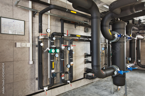 interior of industrial, gas boiler room with boilers; pumps; sensors and a variety of pipelines