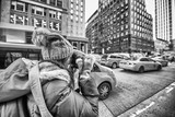 Female photographer taking pictures of New York Cabs in winter - 242687281